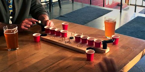 Beer pong, Games, Drinking game, Party supply, Table, Table shuffleboard, Recreation, Flooring, Wood, Floor,
