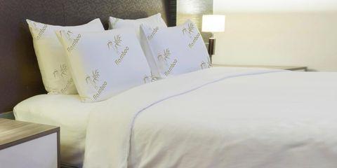 Bed sheet, Bedding, Bed, Duvet cover, Furniture, Textile, Pillow, Bedroom, Bed frame, Room,