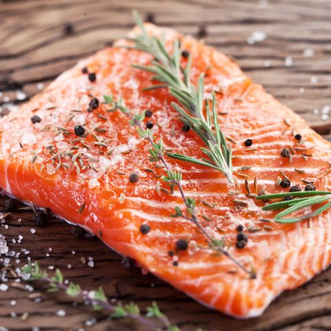 salmon filet on a wooden carving board