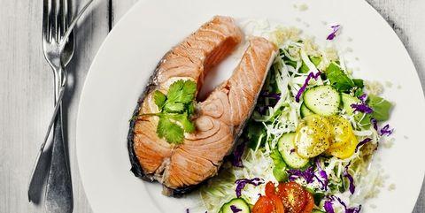 Salmon steak with salad