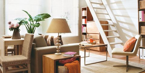 Living room, Furniture, Room, Interior design, Table, Floor, Wall, Building, Coffee table, House,