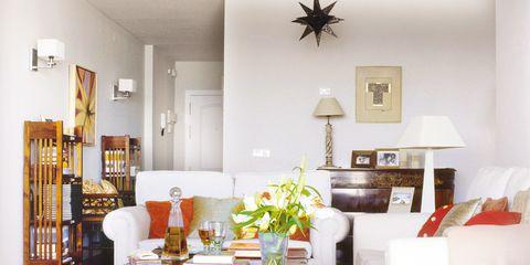 Furniture, Room, Interior design, Living room, Table, Property, Yellow, Floor, Lighting, Home,