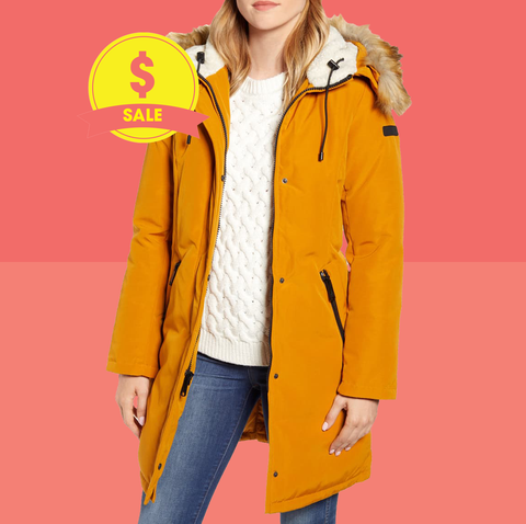 Clothing, Hood, Yellow, Outerwear, Coat, Parka, Overcoat, Jacket, Orange, Fur,