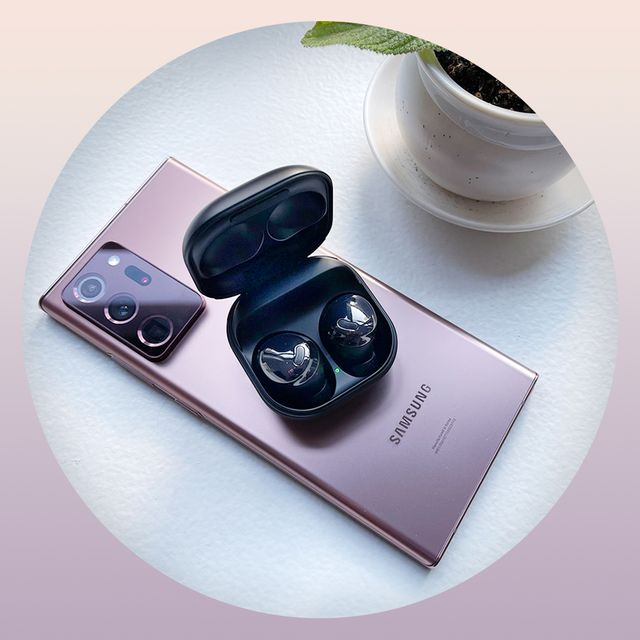 samsung galaxy buds pro on top of phone