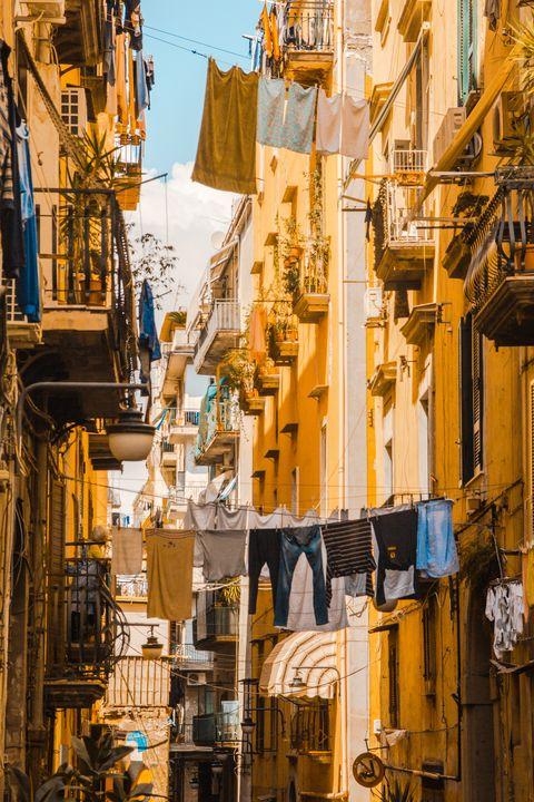 Yellow, Town, Neighbourhood, Street, Urban area, Infrastructure, Architecture, City, Metropolis, Facade,