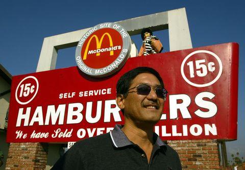 San Bernardino. Nov. 23, 2004. –––– Albert Okura (cq), left, stands under the sign of McDonal's at h