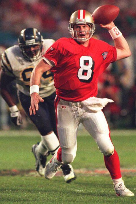 San Francisco 49ers quarterback Steve Young (R) sc