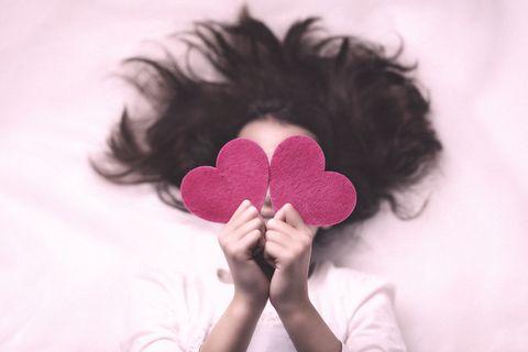 Hair, Pink, Skin, Hand, Petal, Black hair, Love, Heart, Flower, Hair accessory,