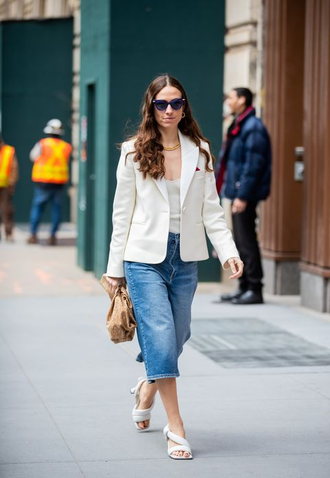 new york, new york   february 12 erika boldrin is seen wearing white sandals, cropped denim jeans, camel bottega bag, white blazer outside michael kors during new york fashion week fall  winter 2020 on february 12, 2020 in new york city photo by christian vieriggetty images