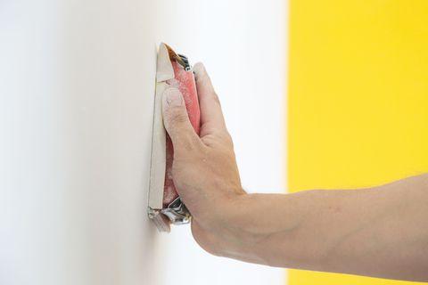 home repairs   sanding walls