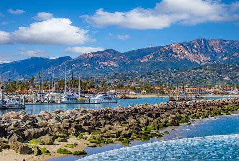 santa barbara marina shoreline breakwater with recreational boats, ca