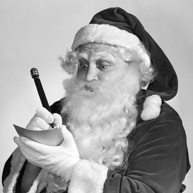 1950s santa claus writing naughty and nice list  photo by cameriqueclassicstockgetty images