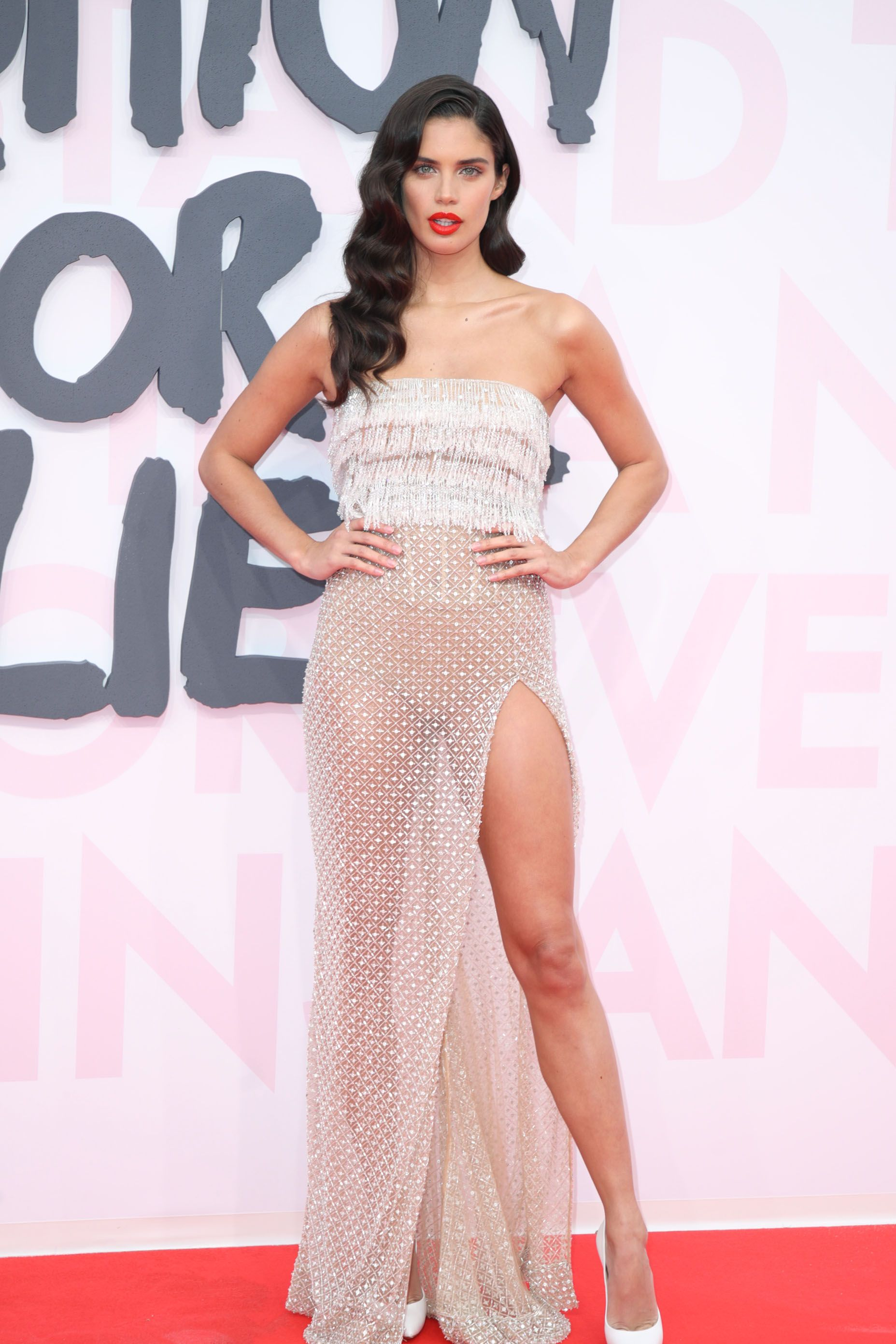 Sara Sampaio On May 13, Sampaio attended the Fashion For Relief party in Cannes, France. The model chose a Roberto Cavalli dress that was covered on top, but completely see-through on the bottom.