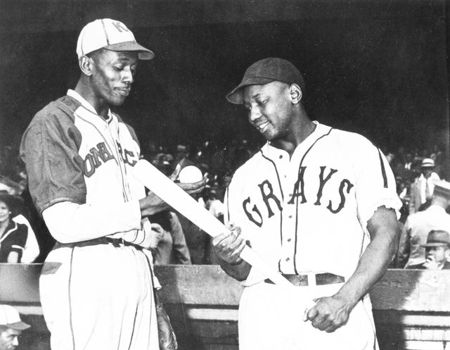 kansas city   1942  satchel paige of the monarchs talks with josh gibson of the homestead grays before a game in kansas city in 1941  photo by mark ruckertranscendental graphics, getty images