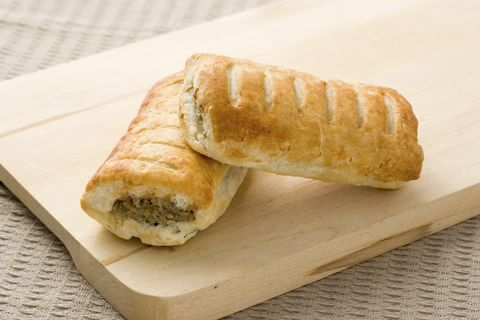 Sausage roll pastry snack with meat on a wooden surface