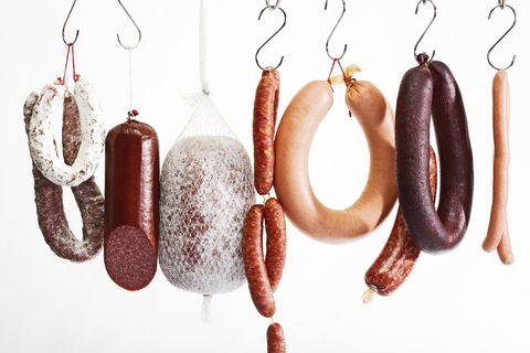Sausages hanging on hooks