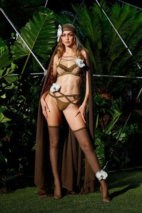 clothing, lingerie, beauty, long hair, leg, navel, photo shoot, jungle, undergarment, muscle,