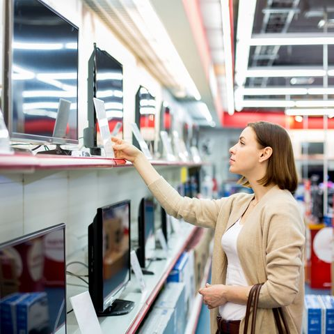 save money fast - woman shopping for TVs