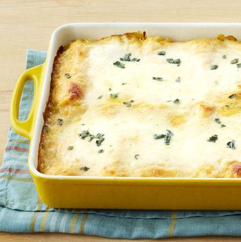 pumpkin lasagna roll ups in yellow casserole dish