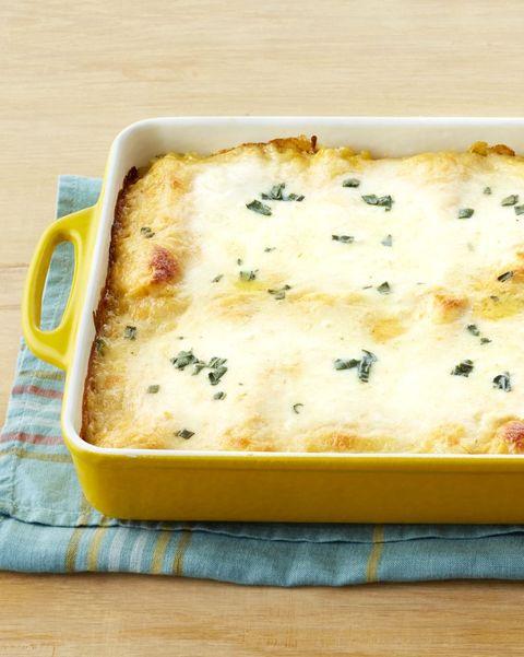 pumpkin recipes lasagna roll ups in yellow casserole dish