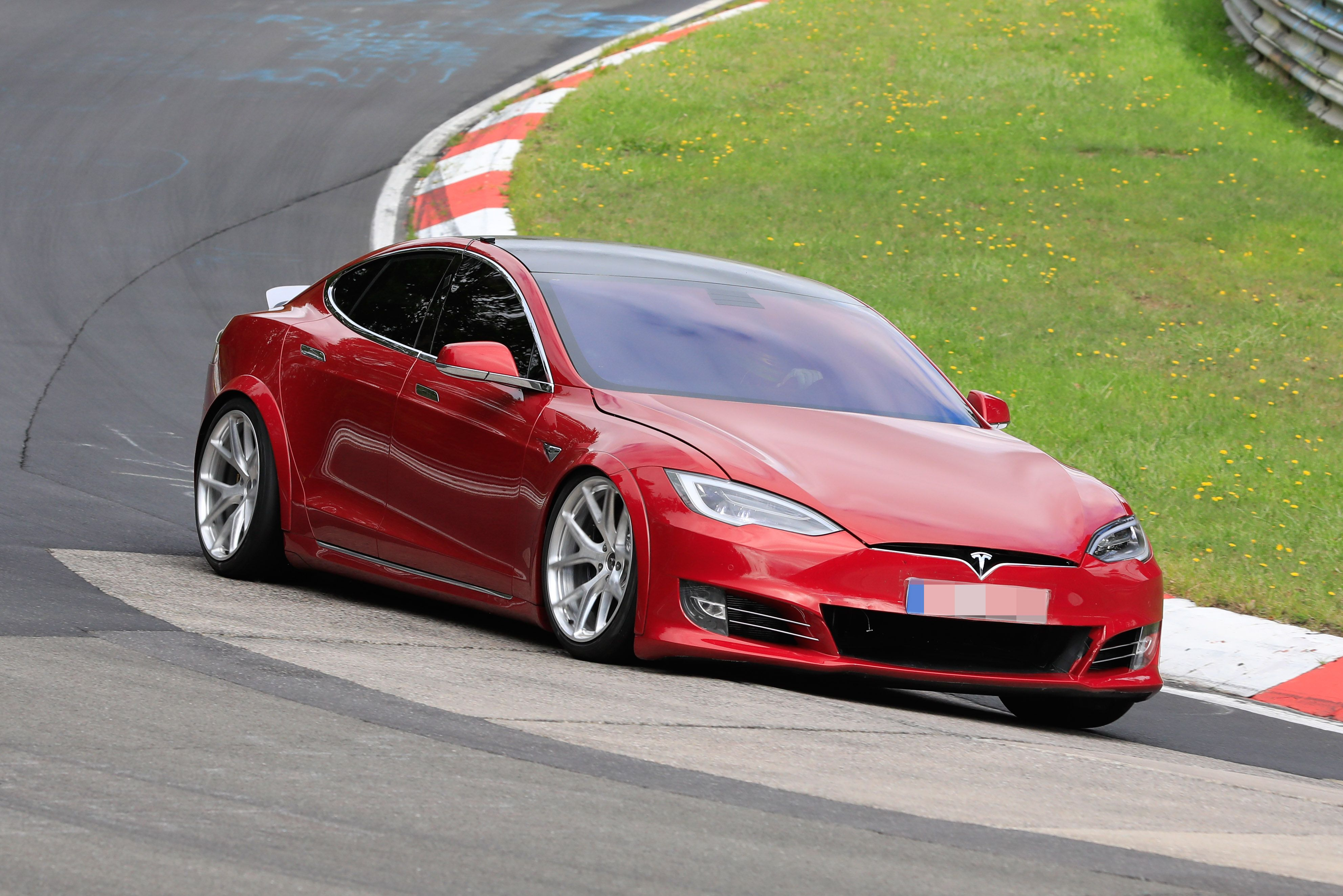 Stripped-Out Tesla Model S Beats Porsche Taycan by 20 Seconds at Nurburgring