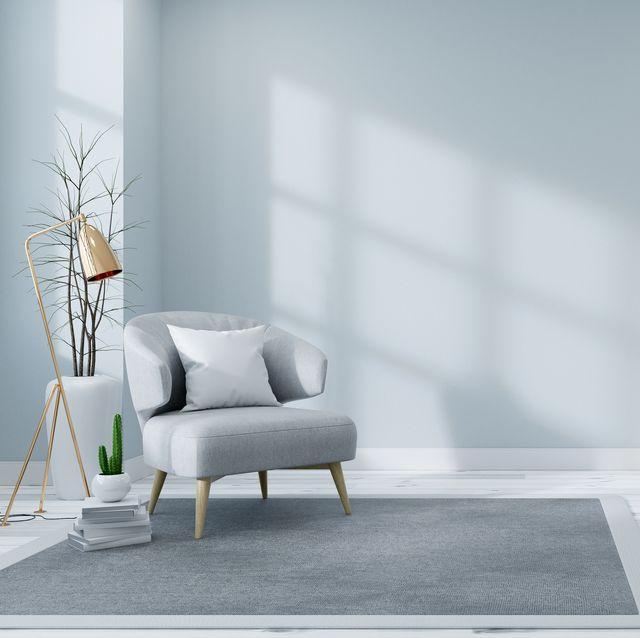 scandinavian interior of living room concept, light gray sofa with gold lamp on white flooring