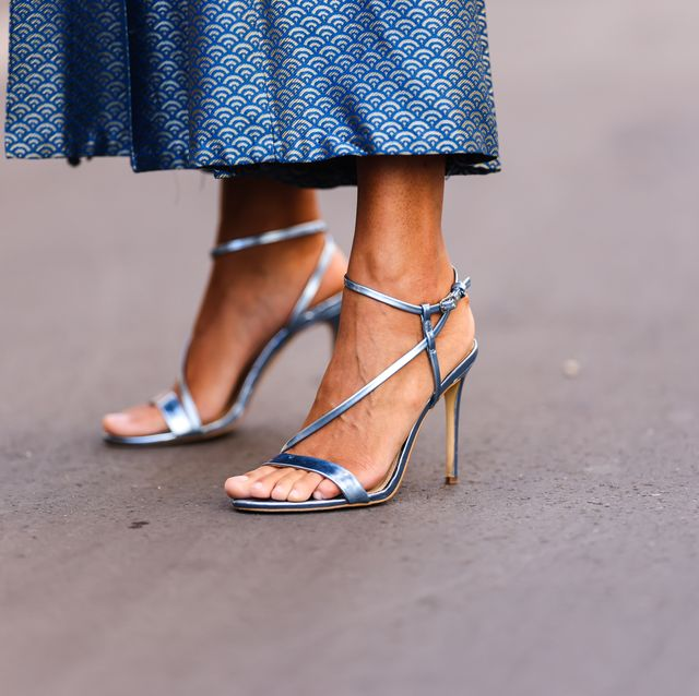 paris, france   may 03 alicia aylies wears a long blue with silver pattern pleated long nice piece vintage skirt, silver shiny leather strappy heel guess pumps shoes, on may 03, 2021 in paris, france photo by edward berthelotgetty images