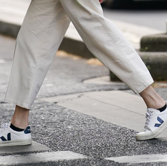 paris, france   june 15 a passerby wears white cropped pants, veja sneakers shoes, on june 15, 2020 in paris, france photo by edward berthelotgetty images