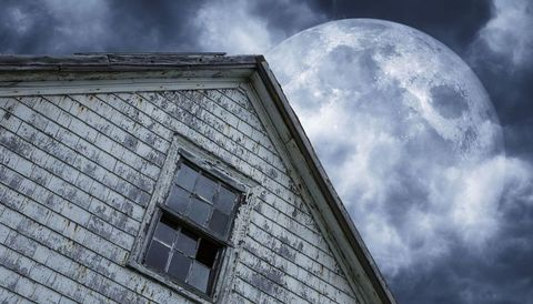 shabby house with moon and clouds above