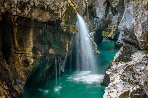scenic view of waterfall in forest,bovec,slovenia