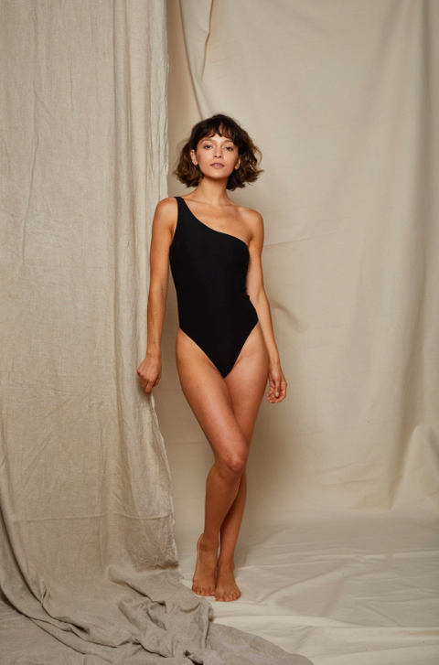 Clothing, Shoulder, Human leg, Leotard, Leg, Beauty, Skin, Photo shoot, Model, Fashion model,