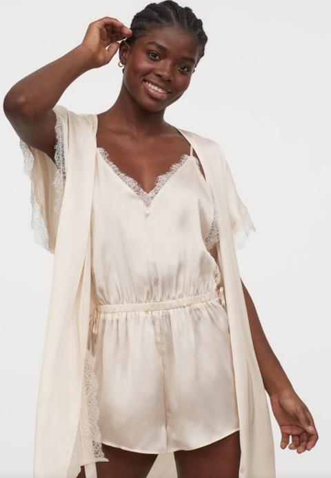 White, Clothing, Fashion, Fashion model, Model, Beige, Outerwear, Neck, Dress, Fashion design,
