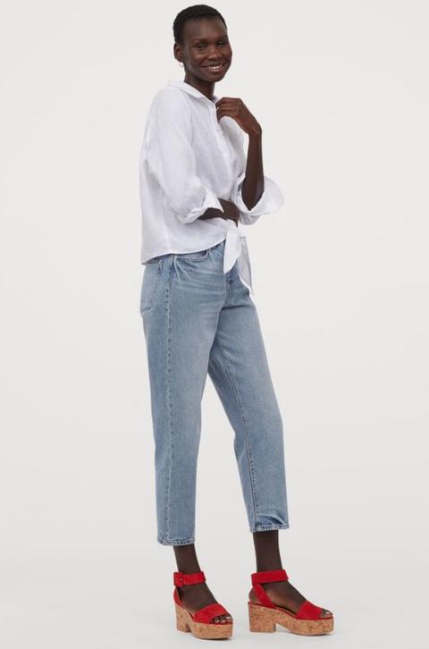 White, Clothing, Denim, Jeans, Standing, Footwear, Trousers, Shoe, Dress shirt, Sportswear,