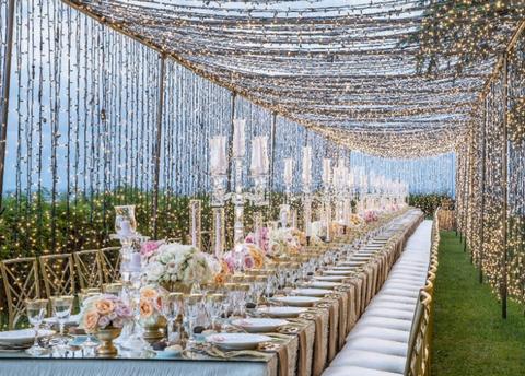 Aisle, Textile, Tree, Plant, Flower, Furniture, Wedding reception, Linens, Plantation, Building,