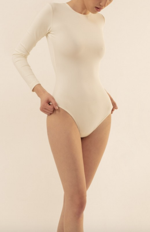 White, Clothing, Skin, Leotard, Shoulder, Leg, Human leg, Thigh, Joint, Human body,