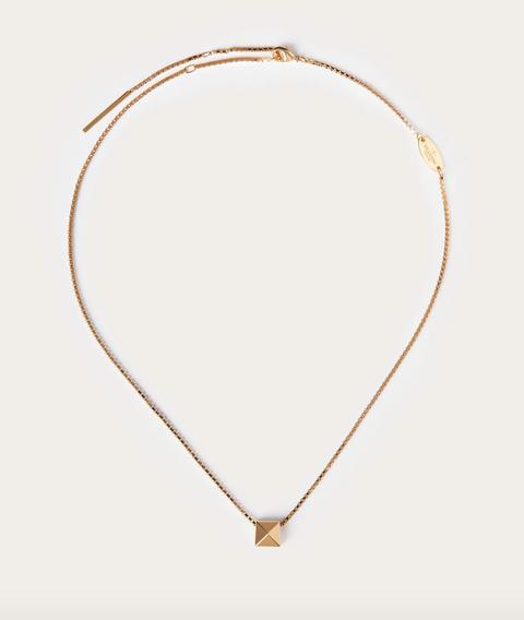 Amber, Jewellery, Tan, Chain, Body jewelry, Beige, Locket, Natural material, Pendant, Circle,