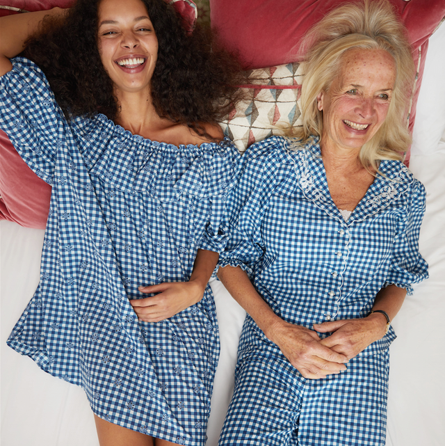 Smile, Fun, Pattern, Happy, Facial expression, Interaction, Dress, One-piece garment, Friendship, Thigh,