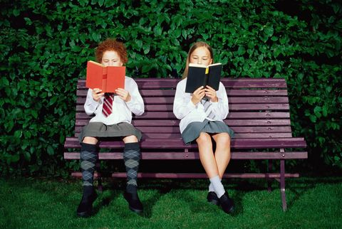 Schoolgirls reading on a bench