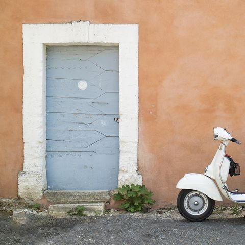 Scooter in doorway, Bonnieux in Provence, France