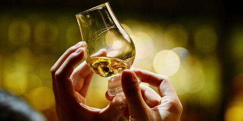 Alcohol, Drink, Alcoholic beverage, Wine glass, Stemware, Distilled beverage, Yellow, Drinkware, Whisky, Wine,