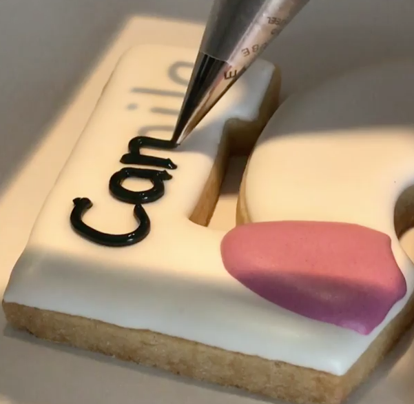 The Brilliant Way this Baker Writes on Cookies with Icing Is