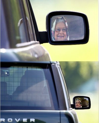 The Queen smiling in her wing mirror will melt the coldest of hearts