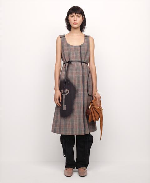 Clothing, Dress, Pattern, Brown, Fashion, Fashion model, Shoulder, Plaid, Day dress, Design,