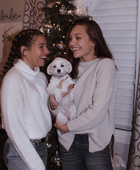 People, Christmas tree, Canidae, Christmas, Outerwear, Companion dog, Family, Child, Fur, Christmas eve,