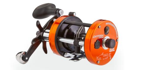Orange, Fishing reel, Recreation, Fishing, Bicycle part, Auto part, Rim, Wheel, Vehicle, Reel,