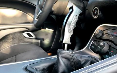 Car, Vehicle, Automotive design, Steering wheel, Compact car, Gear shift, Center console, Supercar,