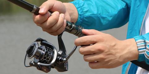 Fishing rod, Fishing, Recreational fishing, Fishing reel, Casting (fishing), Hand, Bicycle part, Recreation, Jigging,