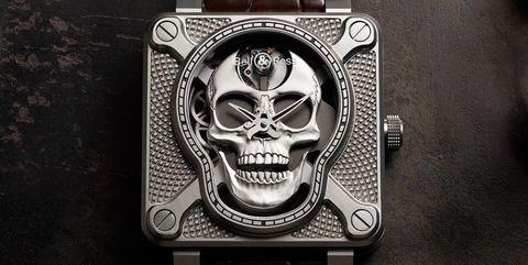 Watch accessory, Fashion accessory, Watch, Font, Strap, Brand, Skull, Titanium, Jewellery, Metal,