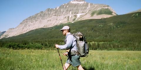 Mountainous landforms, People in nature, Grassland, Mountain, Outdoor recreation, Wilderness, Hiking equipment, Pasture, Backpacking, Mountain range,