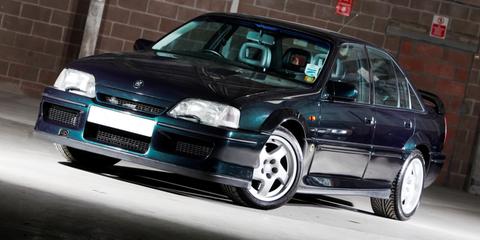 Land vehicle, Vehicle, Car, Sedan, Mid-size car, Automotive exterior, Lotus, Coupé, Rim,